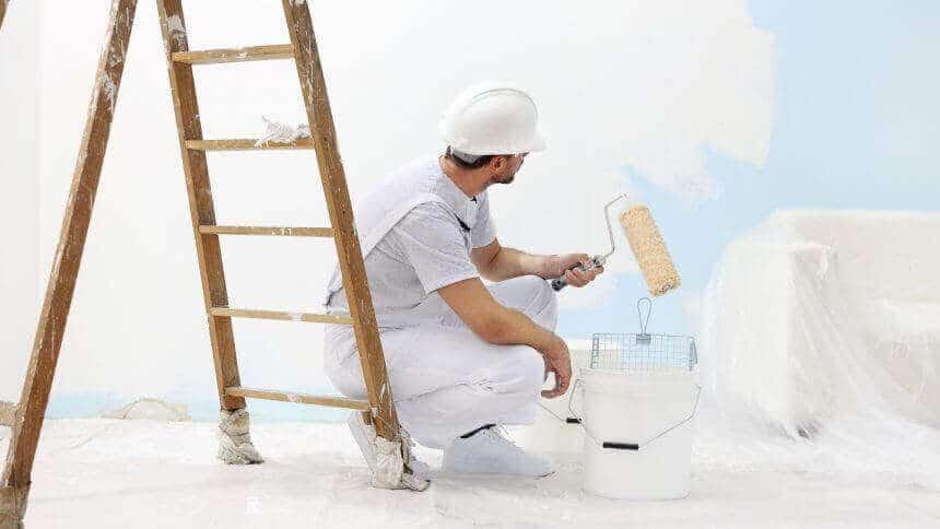 Calgary Painter looking at wall