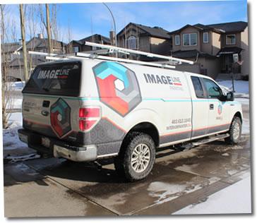 Image Line Painting Truck in Calgary Neighbourhood